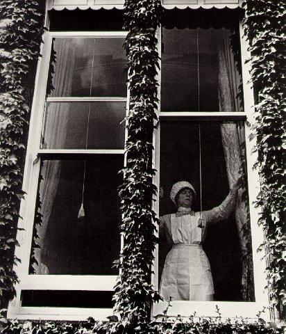 Parlourmaid at a window in Kensington